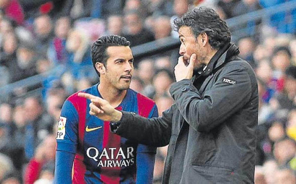 Pedro Rodríguez con Luis Enrique Martínez durante un partido de la temporada 2014-15
