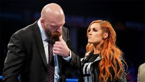 Becky Lynch y Triple H
