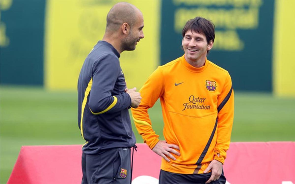 Messi, junto a Guardiola, durante su etapa azulgrana