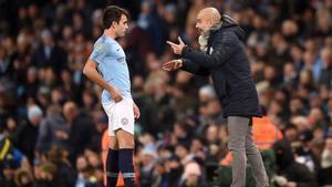 Guardiola y Eric, durante un partido