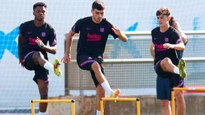 Ansu Fati, Pedri y Gavi en el entrenamiento del Barça