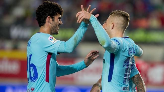 Aleñá, Alcácer y Deulofeu celebran el primer gol ante el Murcia
