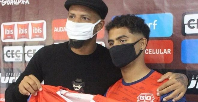Felipe Melo, junto a su hijo Linyker
