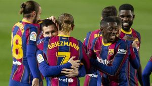 Messi y Griezmann celebran el segundo tanto ante el Athletic