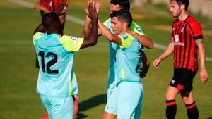 Los jugadores del Granada celebran el primer gol de la tarde