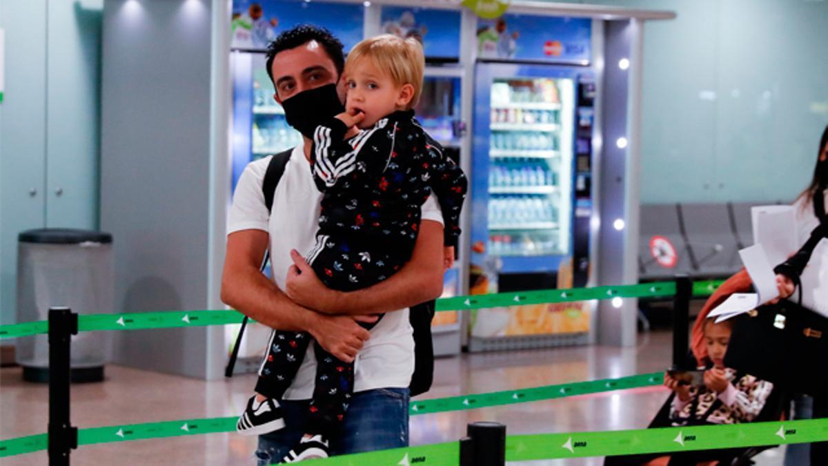 Xavi lands in Barcelona